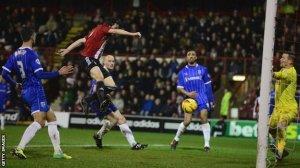 Douglas steers home Brentford's first goal